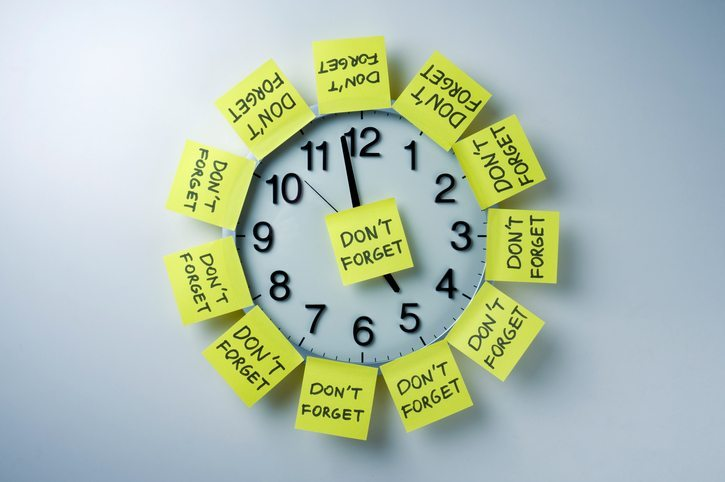 "Clock with ""Don't Forget"" sticky notes"